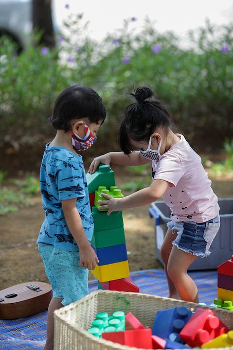 kids playing outdoor. kindergarten class
