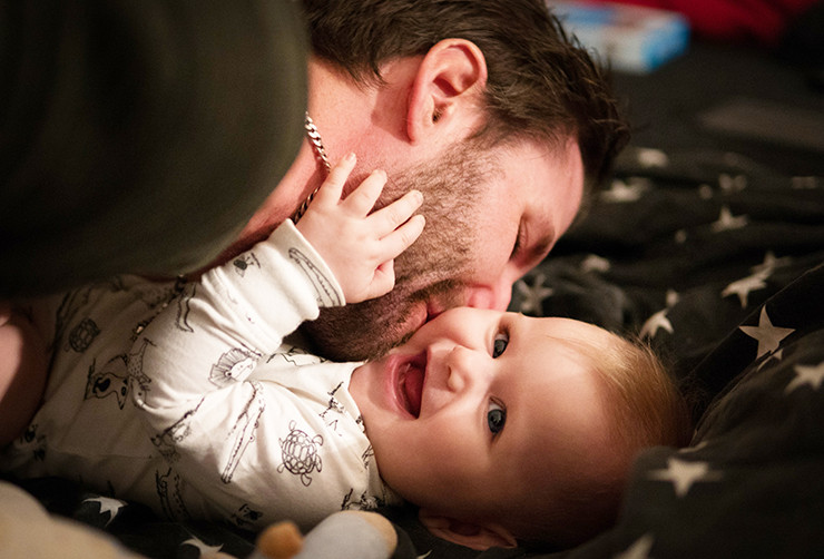 bearded man and smiling baby