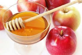 red apples and a bowl of honey