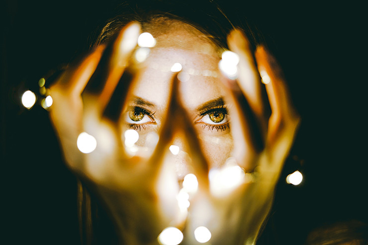 woman looking through her hands