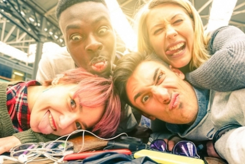 four people making goofy faces