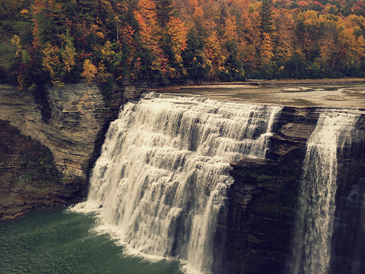 waterfall with fall foliage in the background