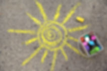 sun drawing and chalks on asphalt.jpg