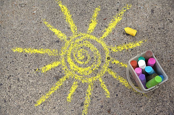 sun drawing and chalks on asphalt.jpg