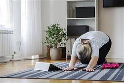 senior woman following tutorial online a