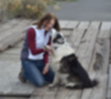 Tania Florance, MA, getting kisses from dog