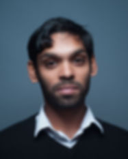 Headshot of Sanjay Saverimuttu, photo by Abdul Sharif