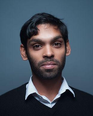 Headshot of Sanjay Saverimuttu, photo by Abdul Sharif