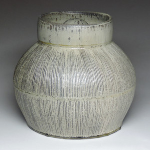 Thrown and carved jar
