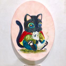 ウィンピーを抱く猫