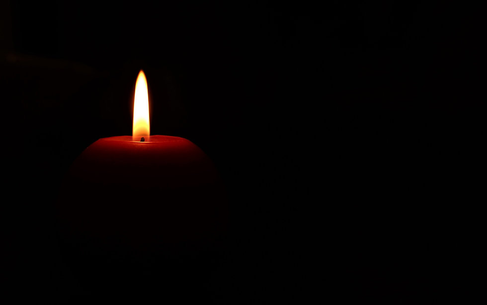 burning-candle-on-a-black-background-sor