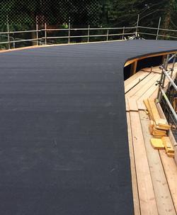 Detailed curved felt roof