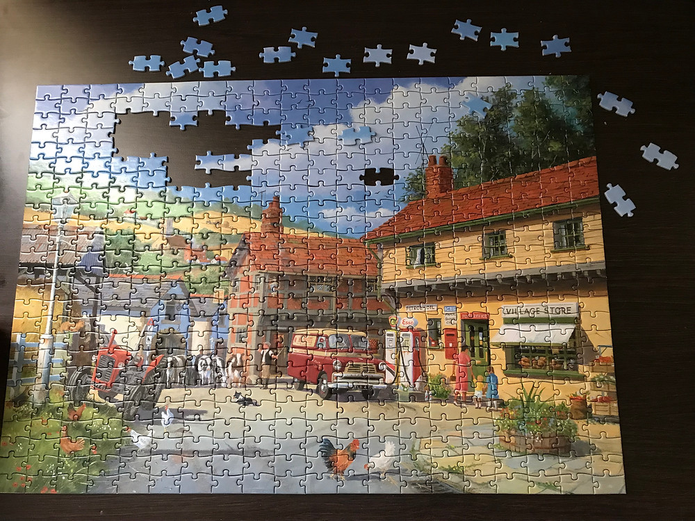 Nearly complete jigsaw apart from some missing pieces in the sky