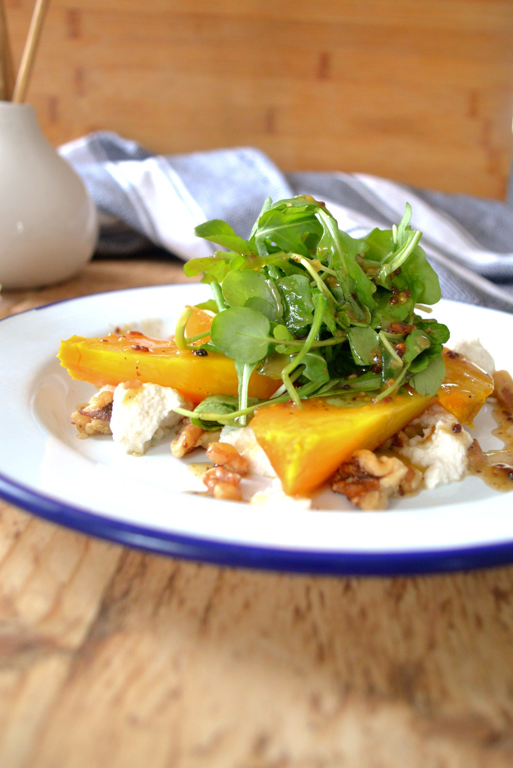Wedges of golden beetroot with walnuts, goat's cheese and salad leaves with a mustard and honey dressing.
