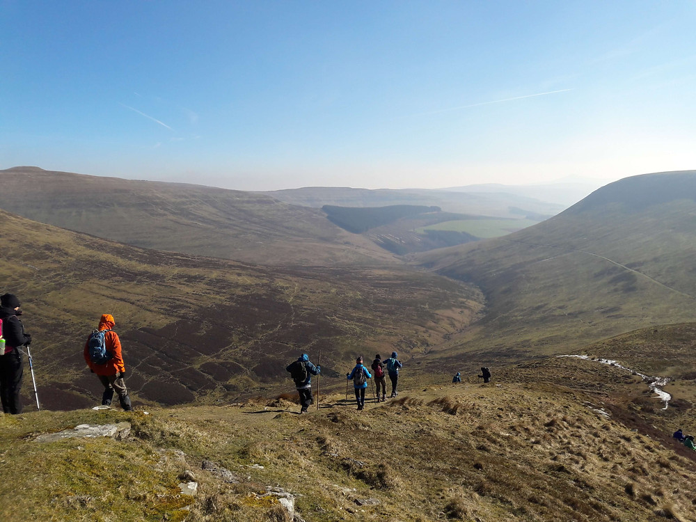 Guided hiking group descending from Waun Fach