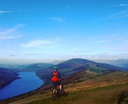 Mountain Biker over Talybont Reservoir.j