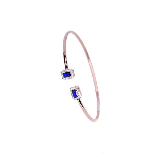 Open bangle bracelet with blue gems