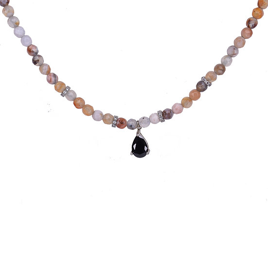 Gemstone necklace with a falling drop