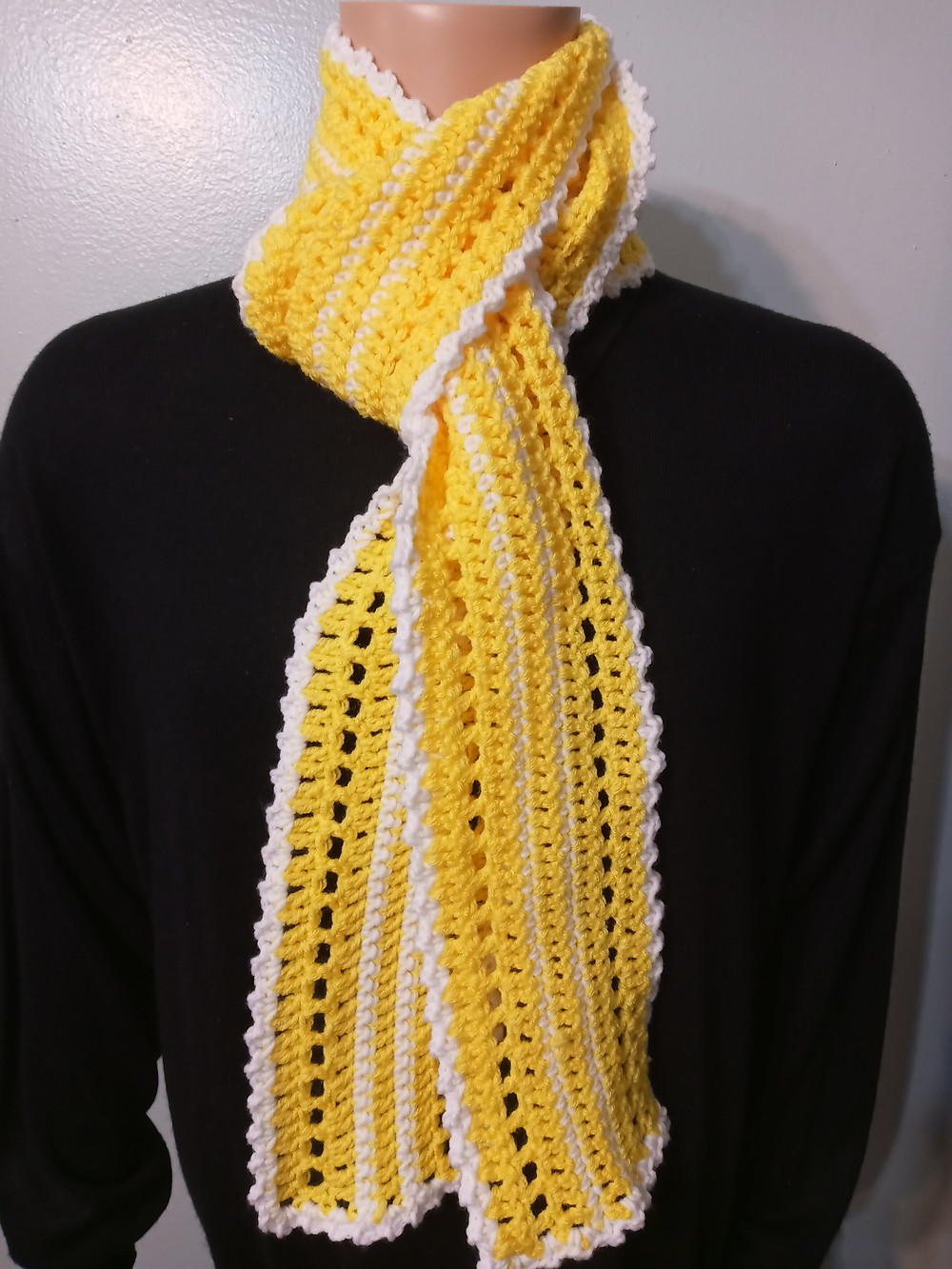Yellow and white scarf handmade and designed by Renaee Smith using acrylic yarn.