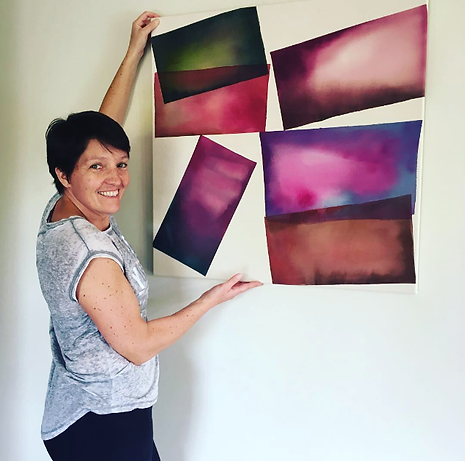 caroline mcintyre with her abstract paintin