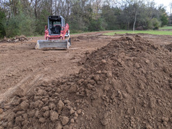Top soil dirt brought in and leveled with skidsteer.
