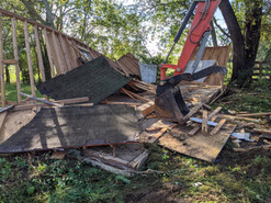 During photo of shed demolition.