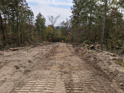Roadway and easement cleared for electrical power to be installed.