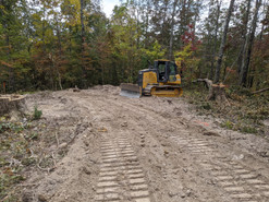 Roadway installed and ready for rock with bull dozer in background.