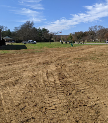 Removing truck tracks, or ruts, in grass to make a smooth yard.