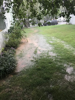 Flooding on the side of the house from storm water.