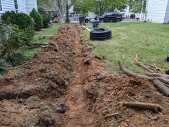 Trench of new french drain installed.