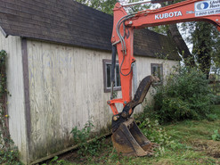 Before picture of shed to be removed with mini excavator.