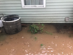 Flooding up against home.