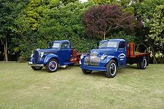 Two beautifully restored Sandford trucks.