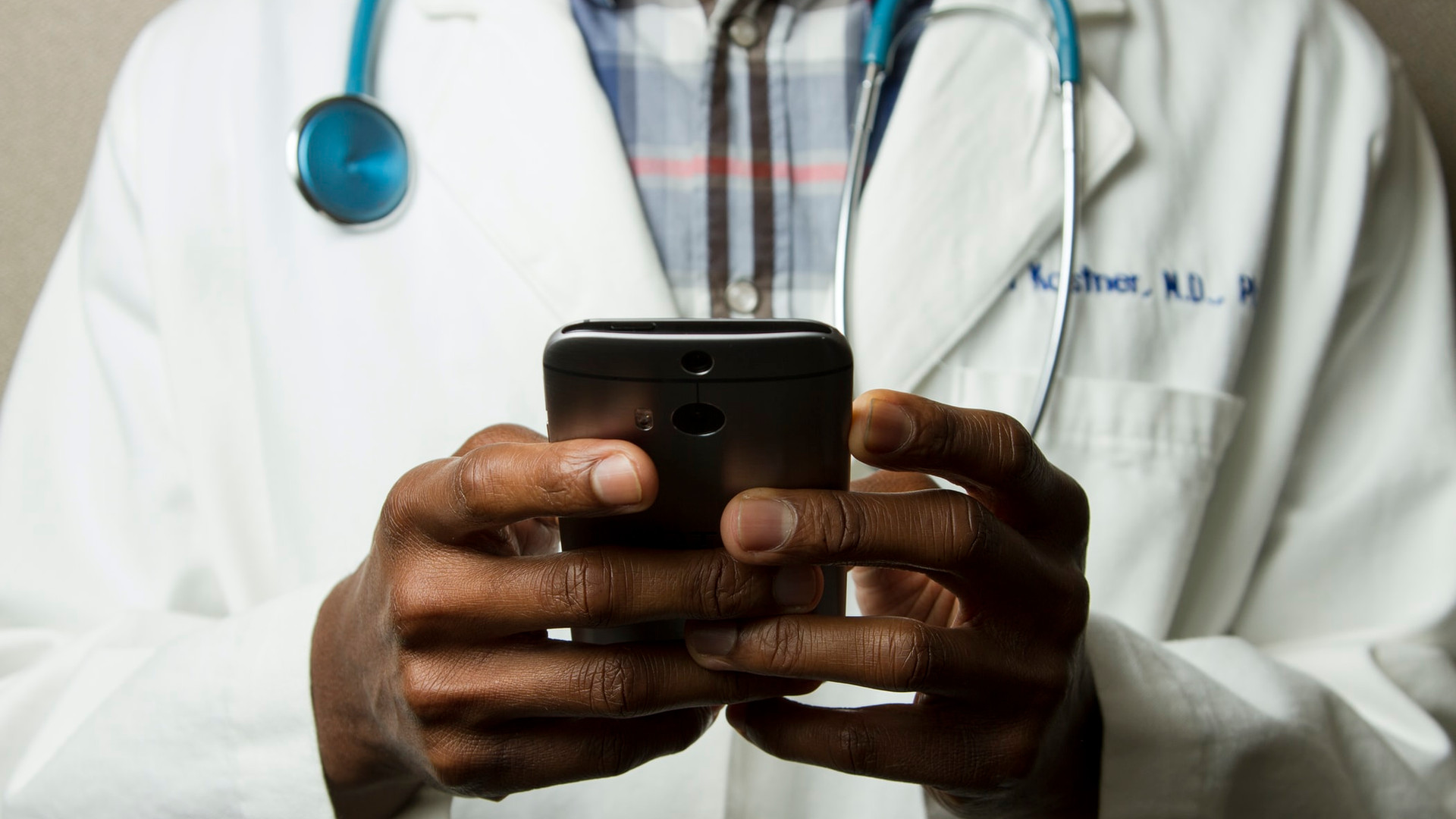 black health professional with phone.jpg