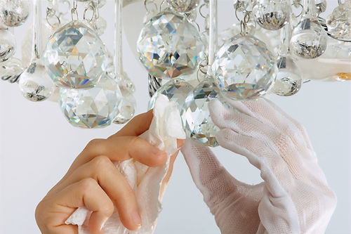 hands%20cleaning%20the%20chandelier%20wi