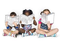 Little Children Reading Sitting Down.jpg