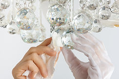 hands cleaning the chandelier with rag, close up.jpg