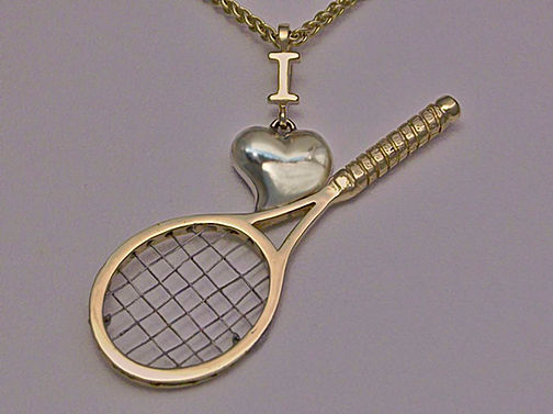Tennis pendants in yellow and white gold