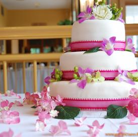Big pink and white birthday cake three l