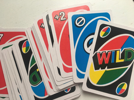 No... You CANNOT stack Draw 2 and Draw 4 cards, UNO confirms