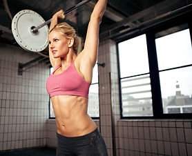 Woman doing shoulder press exercise with