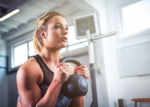 Fitness woman workout with kettlebell tr