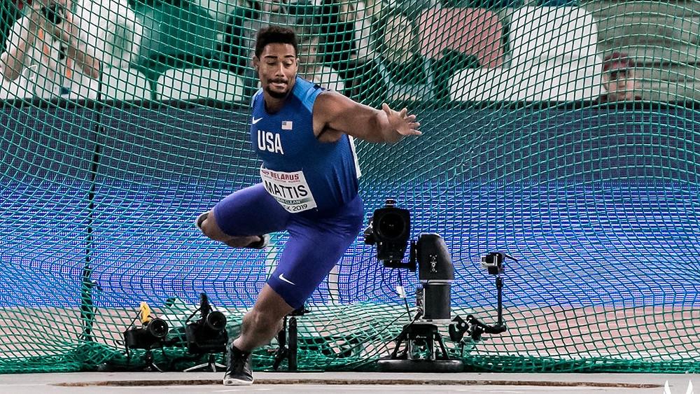 Sam Mattis throws discus in international competition
