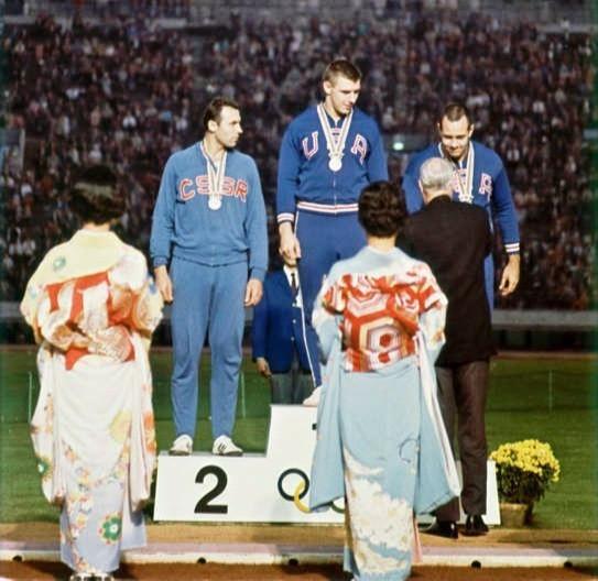 1964 Olympics Men's Discus Medal Ceremony (L to R) Ludvik Danek, Al Oerter, Dave Weill