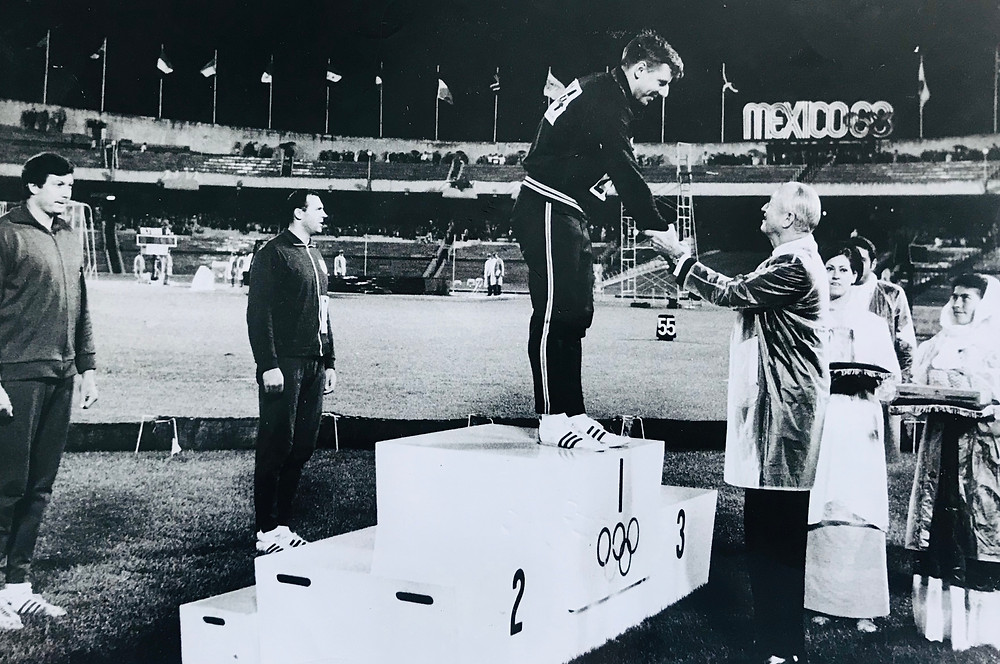 Al Oerter accepting his gold medal at the 1968 Olympics in Mexico City