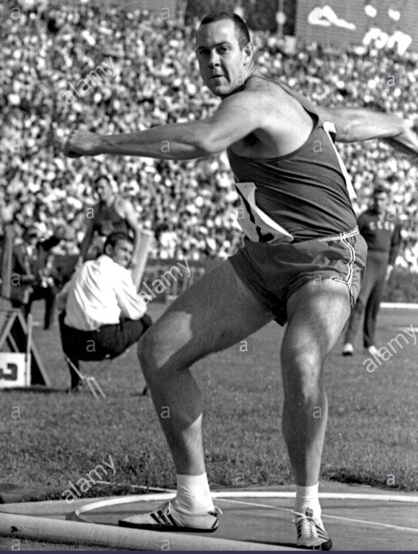 Olympian Dave Weill, Stanford '63, throwing discus in competition