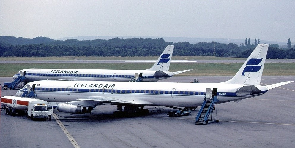 A pair of Douglas DC-8's (early 80's) probably same plane flown by Al Oerter & Company