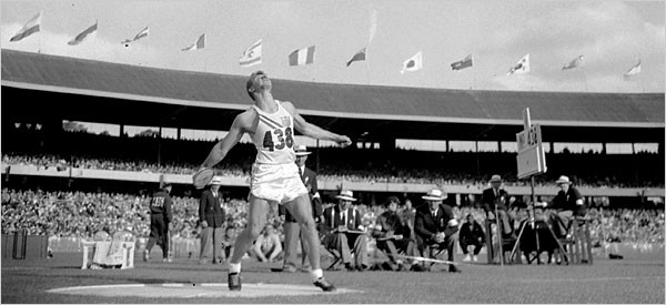 Al Oerter throws the discus for his first Olympic Gold Medal