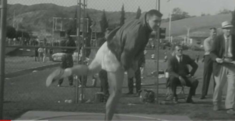 Al Oerter in ski jacket to protect neck injury, 1962